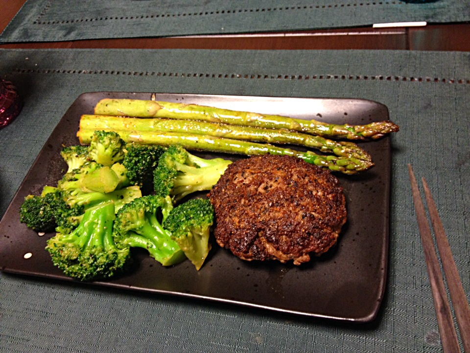 Hamburger with broccoli and lemon butter asparagus