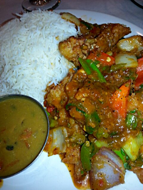 cauliflower Manchurian.  marinated  fried with soy sauce,  peppers, onion, and chili sauce.  with basmati rice.