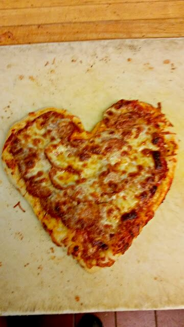 Heart shaped pepperoni and cheese pizza