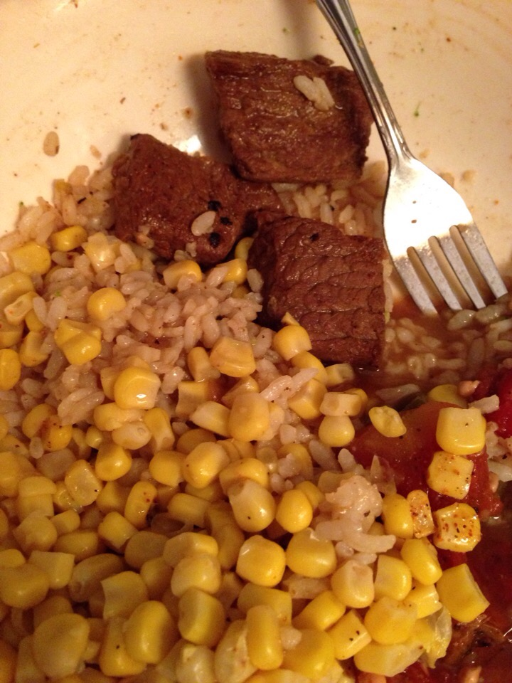 Rice and gravy with beef, smothered okra and corn