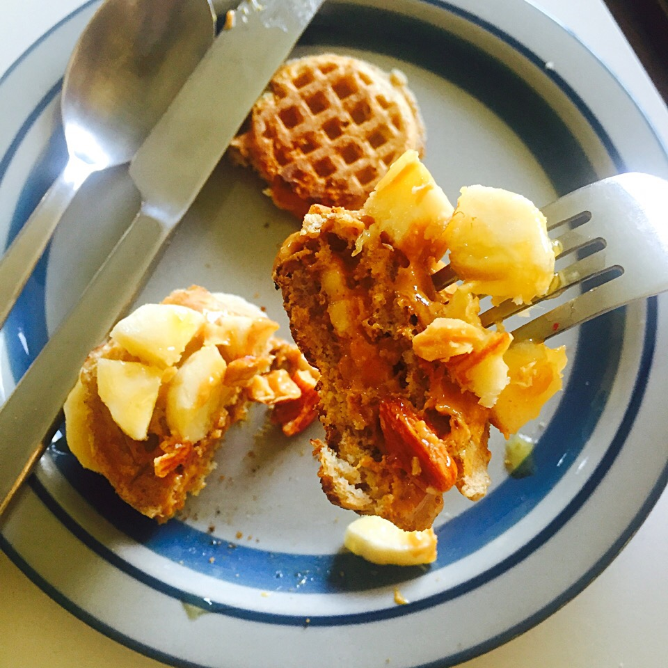 Mini whole wheat organic waffles with peanut butter, banana, almonds and honey