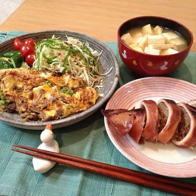 Ikameshi(Stuffed squid rice). Avocado Natto Omelet with salad. Tofu and Deep-fried bean curd miso soup.