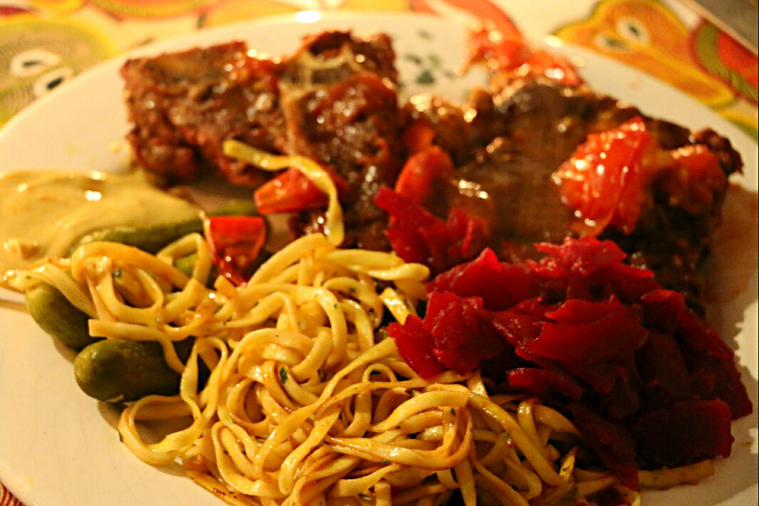 steak with noodles and red cabbage