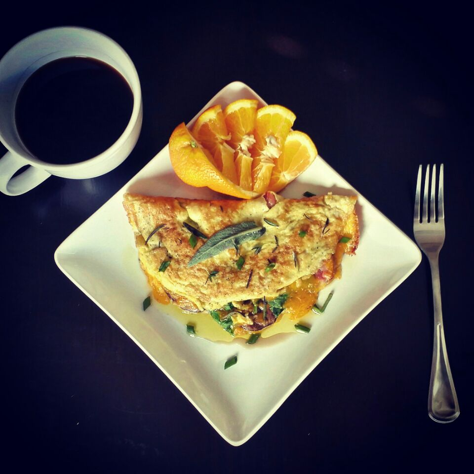 Ham & Cheddar Omelette w/ Spinach & Mushroom, Garnished w/ Fresh Herbs & Extra Virgin Olive Oil