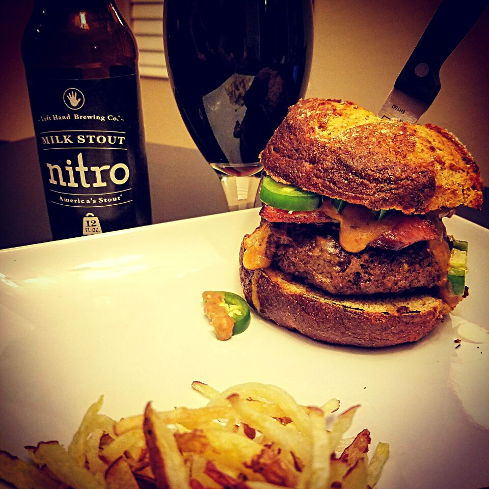 Wisconsin Tavern Burger stuffed w/ Real Wisconsin Sharp Cheddar Cheese & Red Jalepeno Chips, topped w/ Bacon & Fresh Jalepenos, smothered w/ Nitro Milk Stout Be
