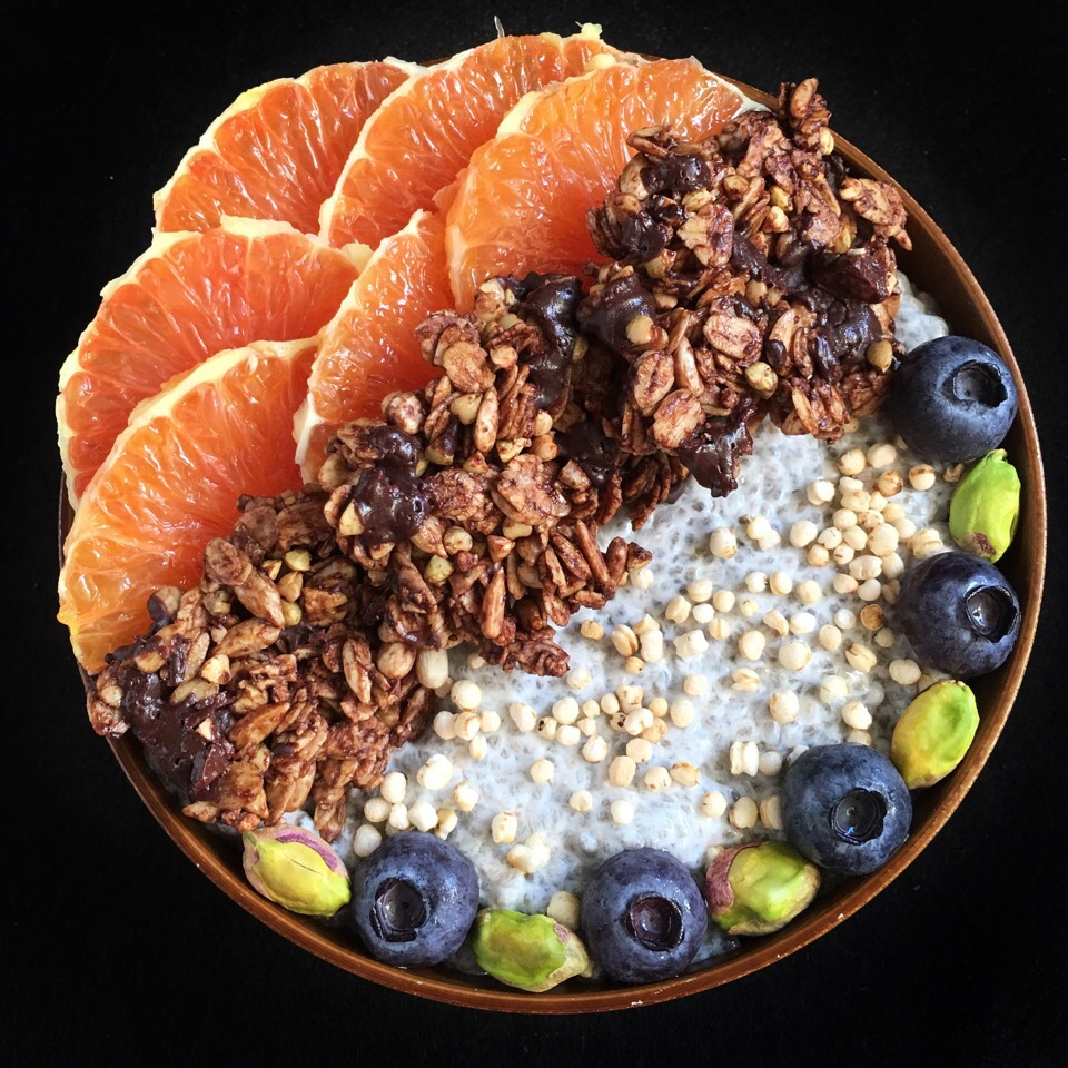 Coconut chia pudding with chocolate granola clusters, fruits and pistachios