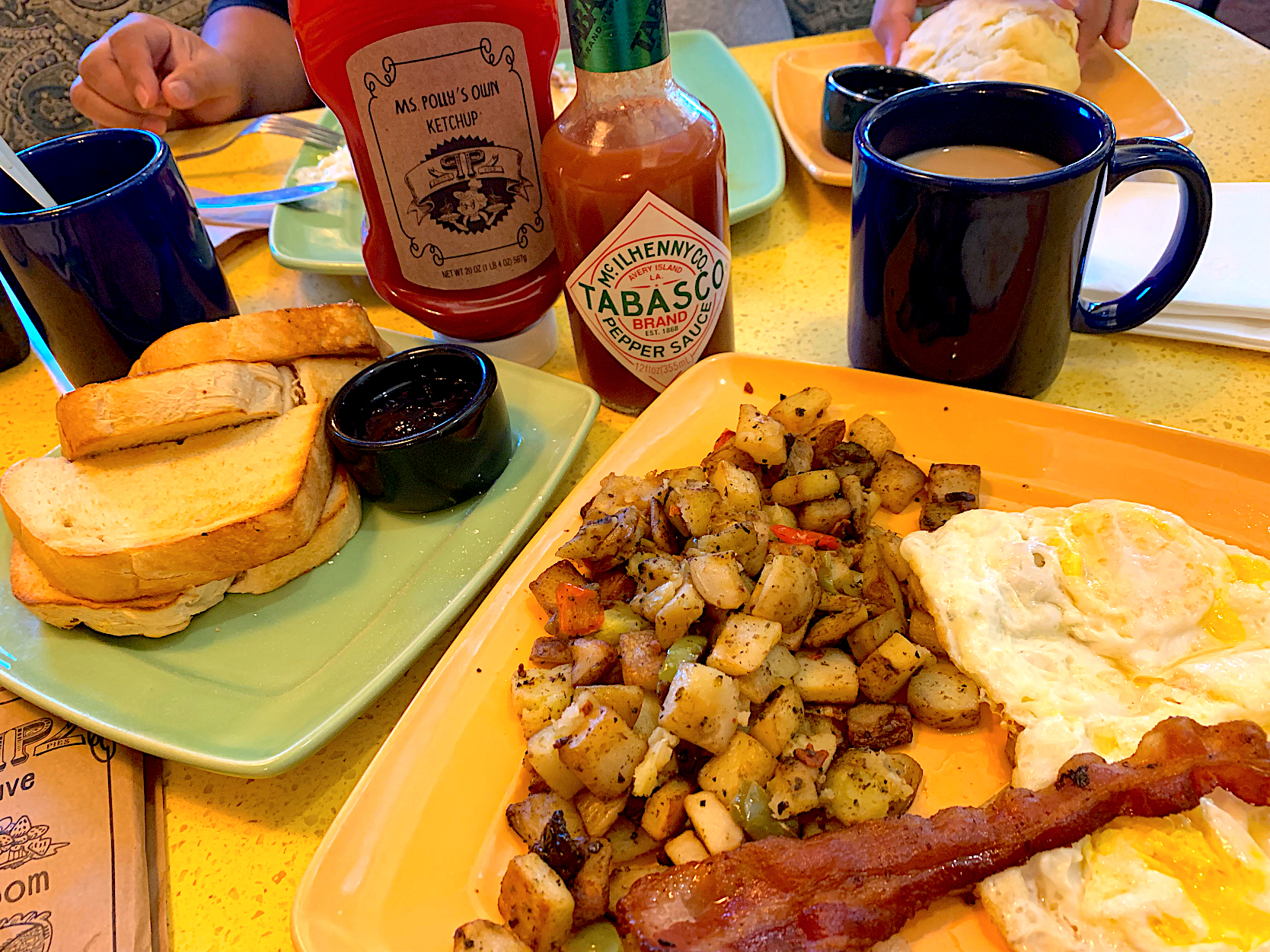 Country breakfast~eggs, bacon, country potatoes, & homemade freshly baked sourdough toast