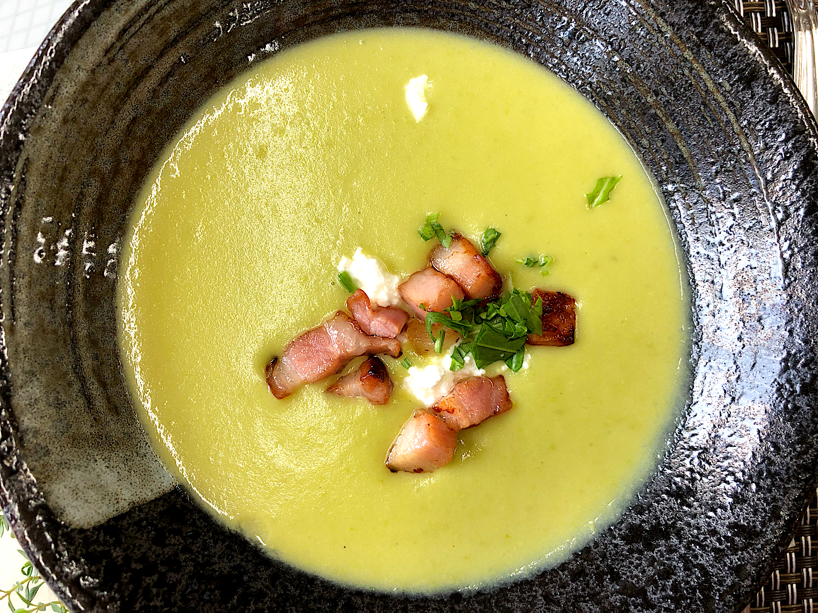 Green pea soup with cottage cheese and crispy bacon