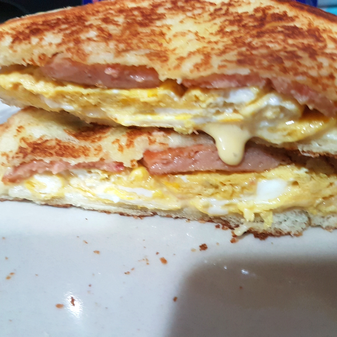 Luncheon meat fried egg cheese sandwich