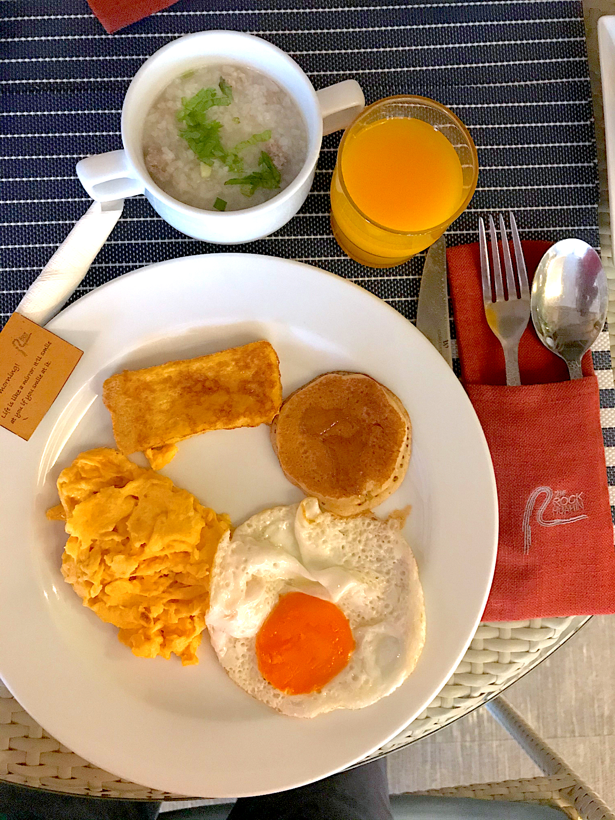Eggs and French toast, pork congee and orange juice