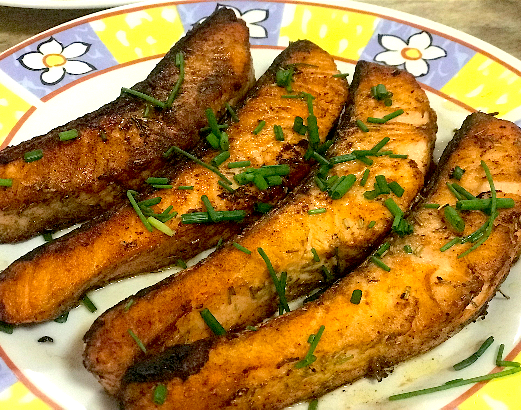 Butter mustard and honey sauce salmon grilled with rosemary herbs and chives for the topping