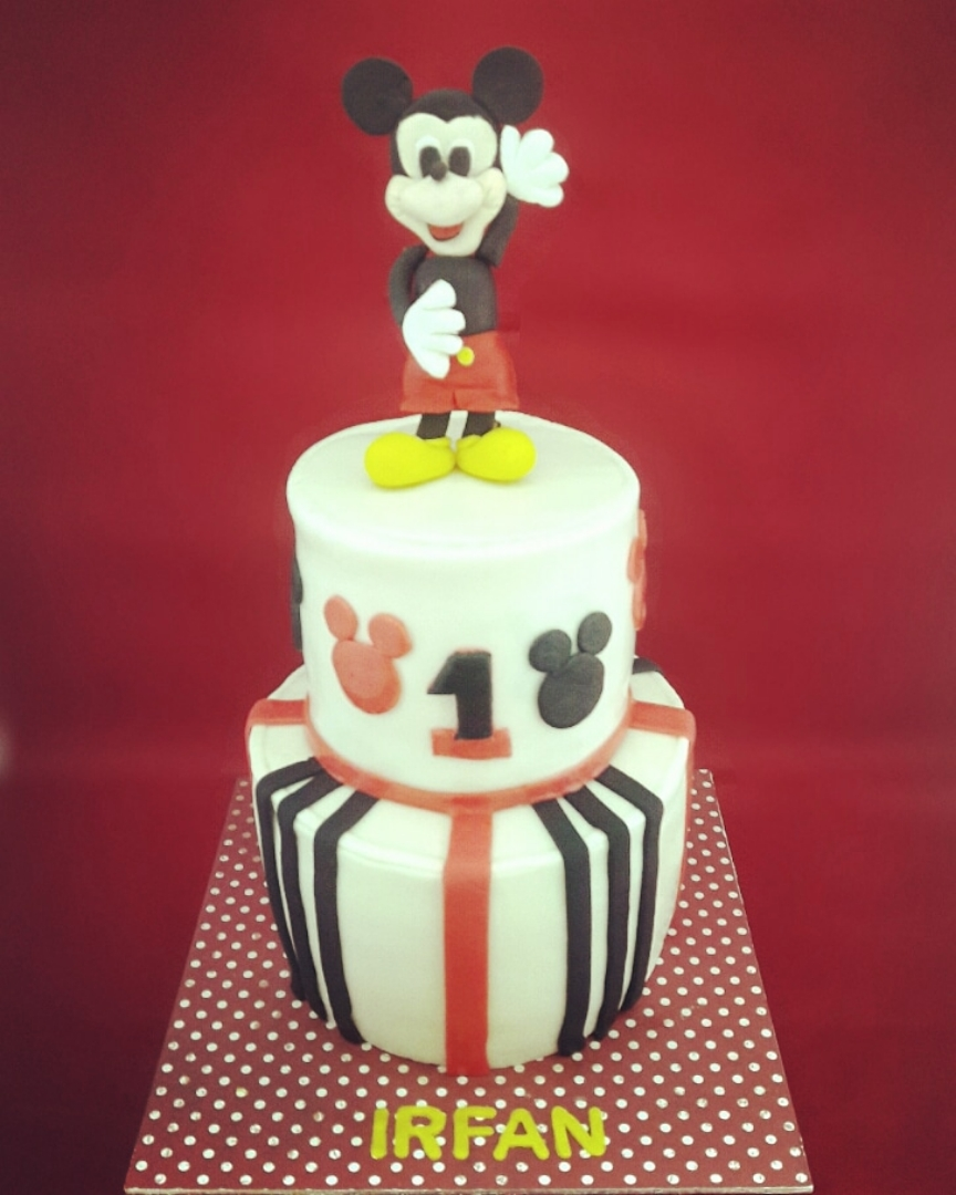♡ Mickey Mouse Cake  A 3 kg 2 tiers Mickey Mouse theme birthday cake. Made of chocolate sponges. Layered with dark chocolate ganache and diced milk chocolates with peppermint filling. Frosted with peppermint flavoured Hershey chocolate swiss buttercream. Covered with fondant.