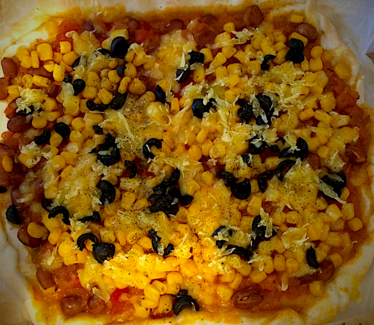 Vegan pizza with olives and corn 🍕