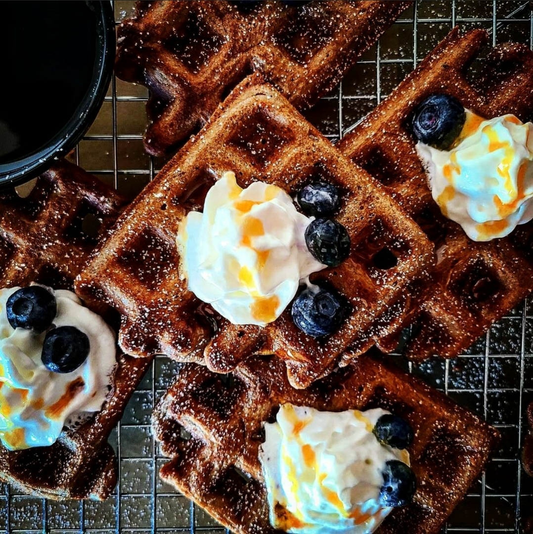Cacao Paleo Waffles with Blueberries and bourbon maple syrup