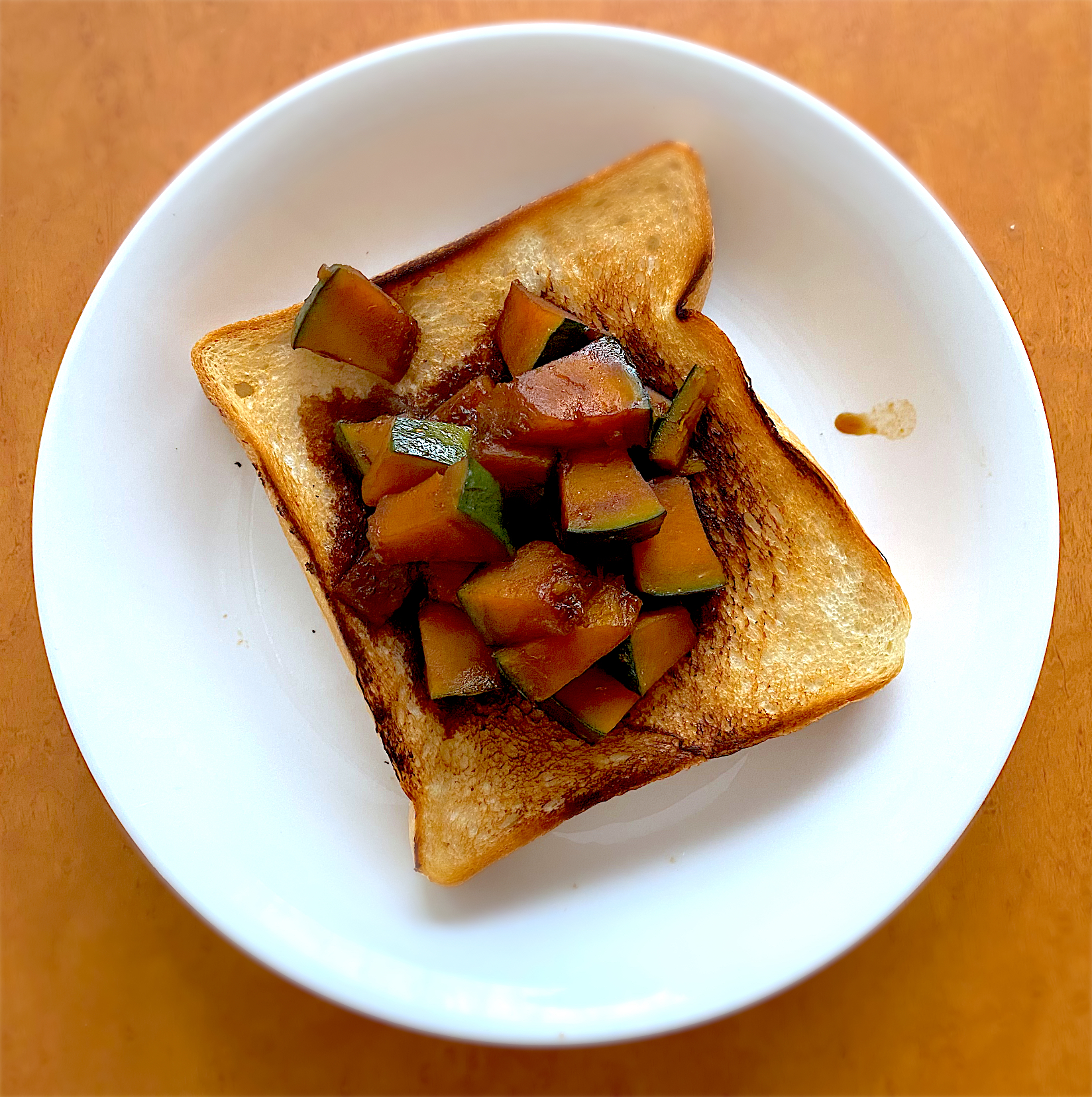 Brunch with bread and boiled pumpkin including brown sugar. Simple and easy food to make.