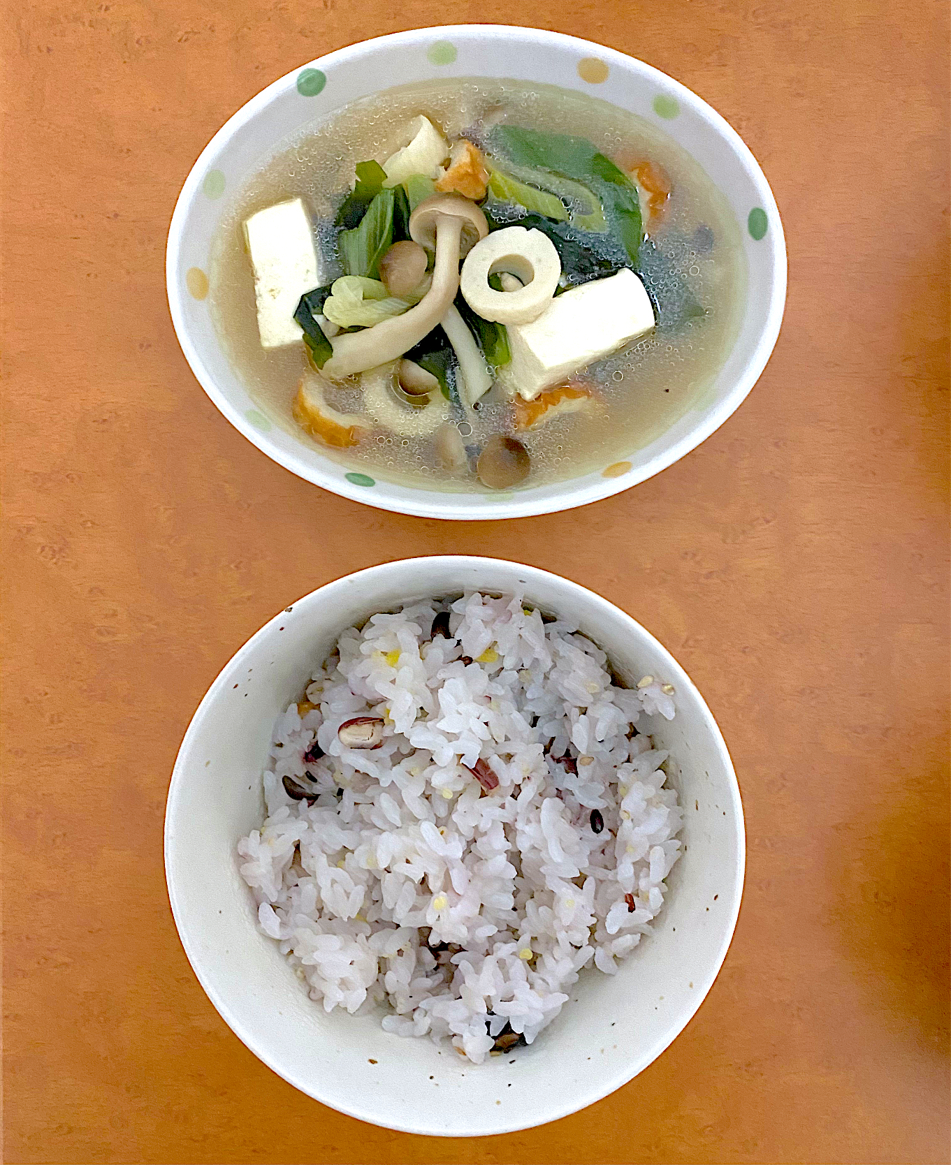 Dinner with simple food, a cup of mix rice and tofu mix soup