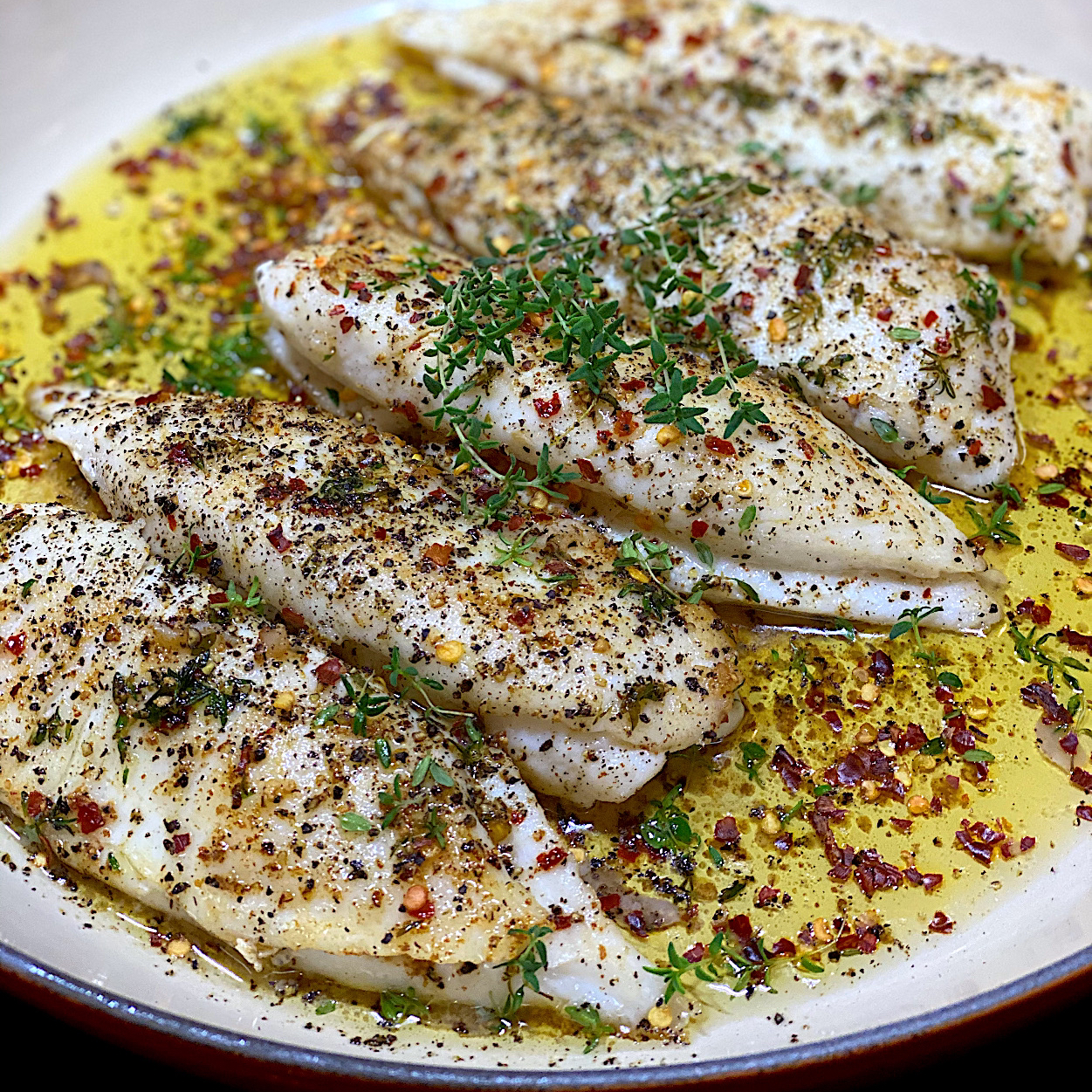 Pan fried fish, herb infused lemon butter sauce