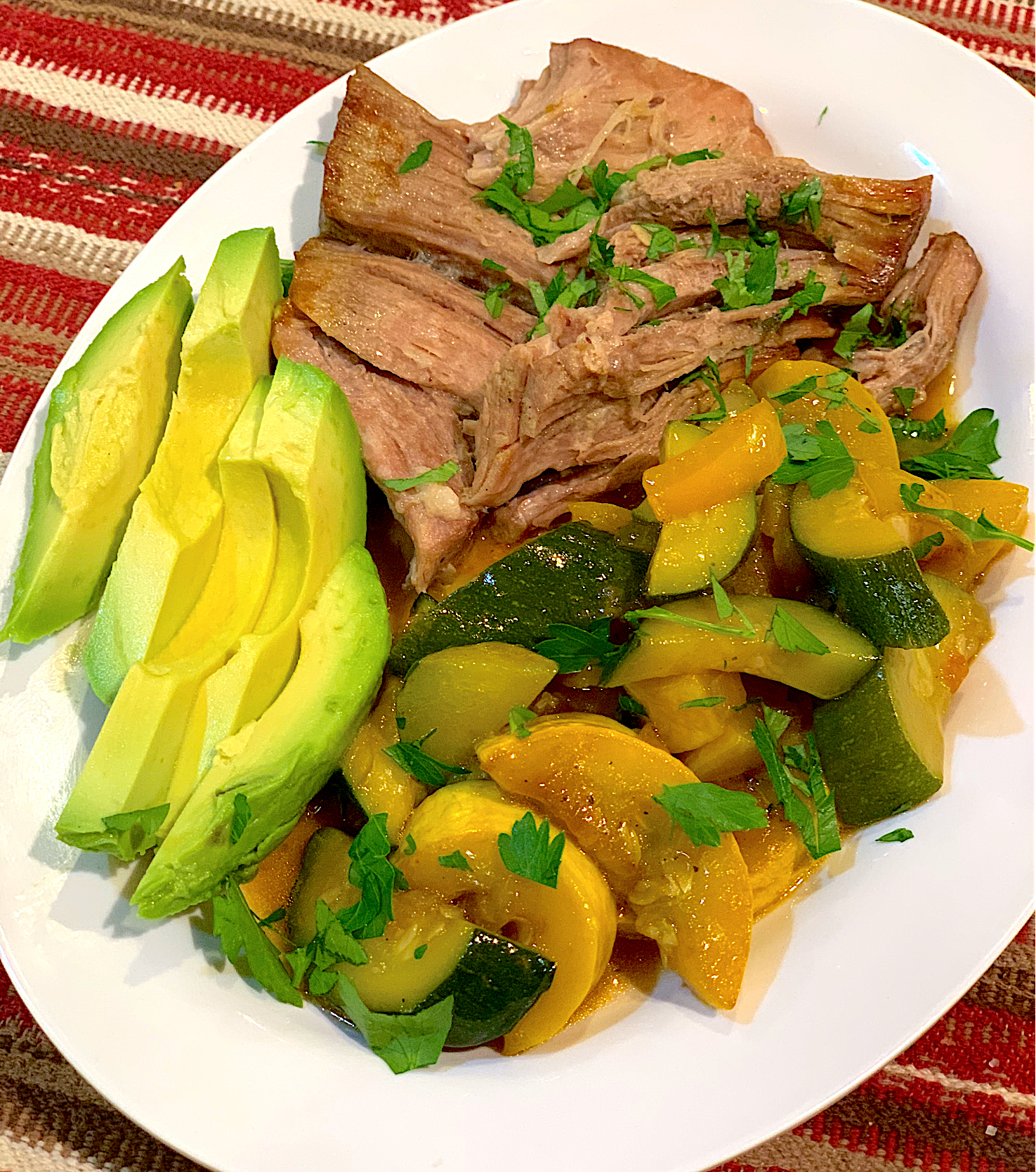 Keto Carnitas and Sauteed Veggies. Sliced avocado 🥑 on the side 😋