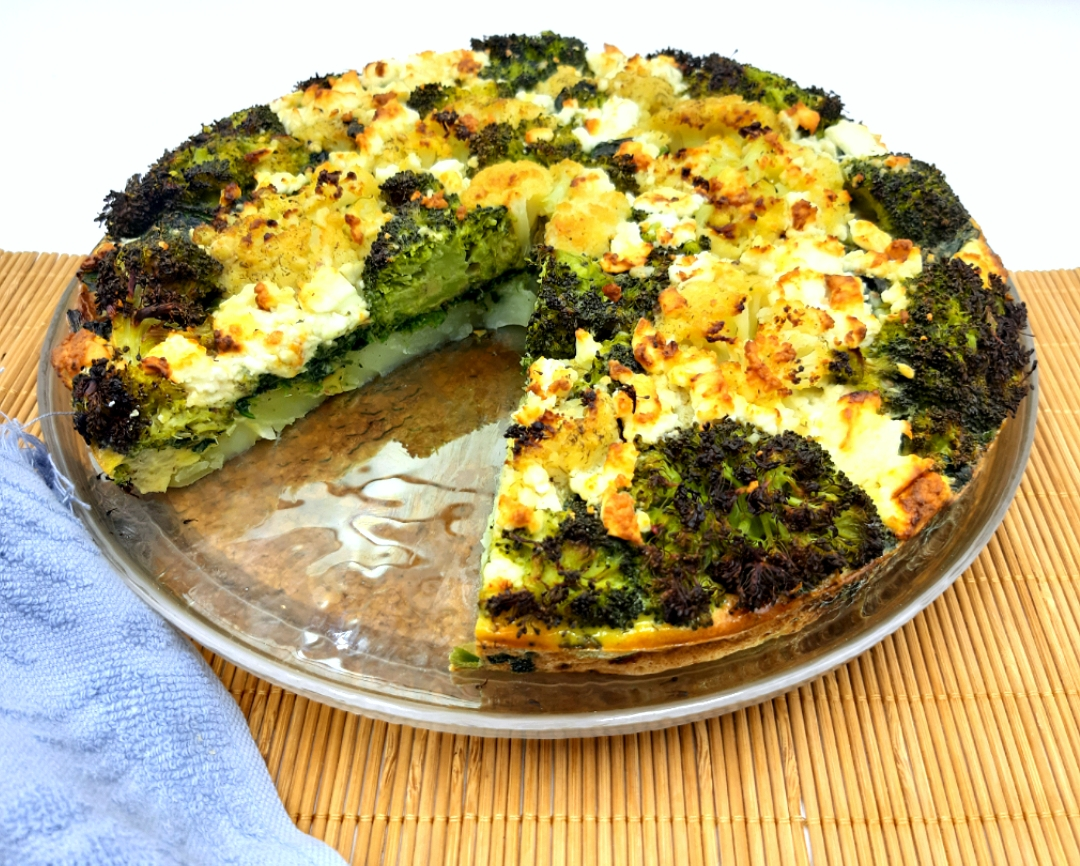 omelette with cauliflower broccoli and spinach and greek feta cheese in the oven